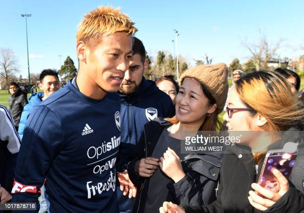 Japanese football player Keisuke Honda greets fans after training for the first time with Melbourne Victory who are preparing for the start of...
