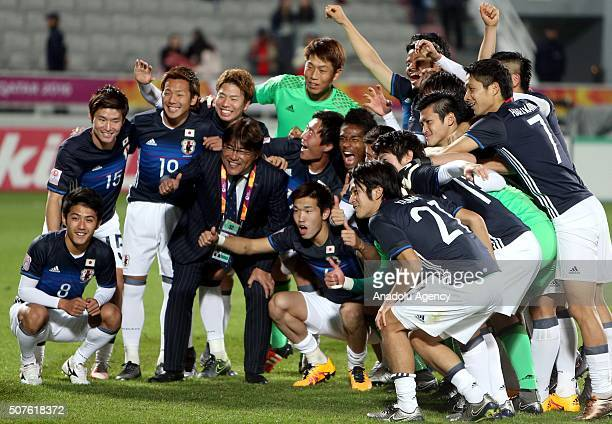 Japanese footballers celebrate after scoring a goal during the AFC U23 Championship final match between South Korea and Japan at the Abdullah Bin...
