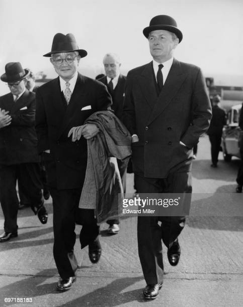 Japanese Foreign Minister Aiichiro Fujiyama is met by British Foreign Secretary Selwyn Lloyd on his arrival at at London Airport 27th September 1957