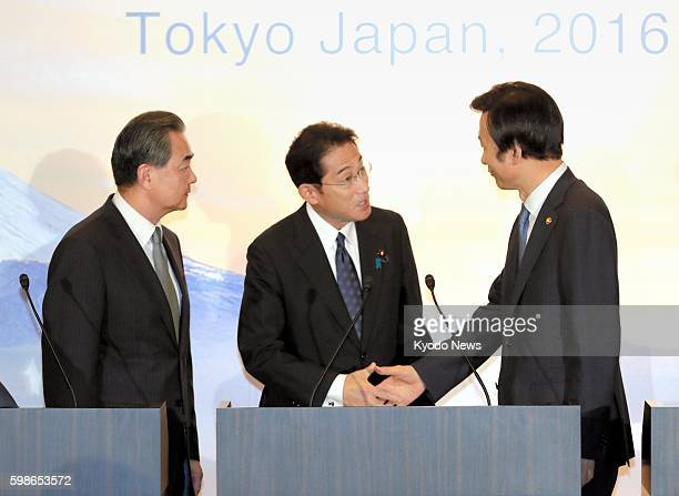 Japanese Foreign Minister Fumio Kishida and his South Korean counterpart Yun Byung Se shake hands after a joint press conference in Tokyo on Aug. 24...