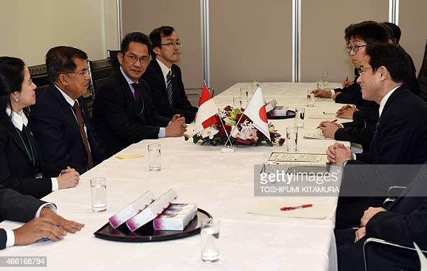 Japanese Foreign Minister Fumio Kishida listens to Indonesian Vice President Jusuf Kalla during their bilateral meeting while attending the third UN...