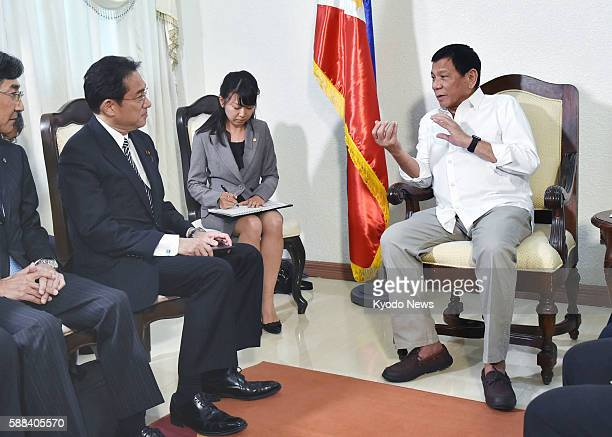 Japanese Foreign Minister Fumio Kishida meets with Philippine President Rodrigo Duterte in the city of Davao in the southern Philippines on Aug 11...