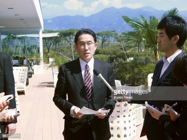 Japanese Foreign Minister Fumio Kishida speaks to reporters in the suburbs of Lucca Italy on April 11 after attending a meeting of the Group of Seven...
