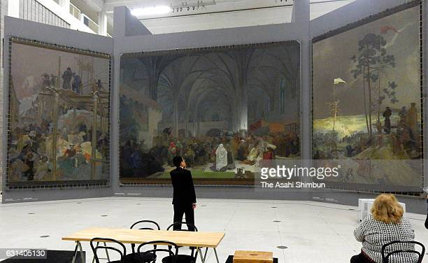 Japanese Foreign Minister Fumio Kishida watches the Slav Epic by artist Alfons Mucha at the National Gallery in Prague on January 8 2017 in Prague...