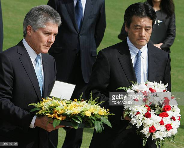 Japanese Foreign Minister Katsuya Okada and and Australian counterpart Stephen Smith prepare to lay wreaths at the State War Memorial of Western...