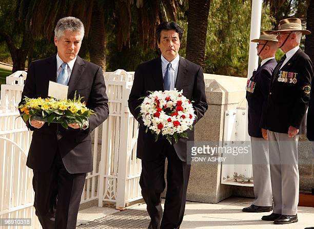 Japanese Foreign Minister Katsuya Okada and his Australian counterpart Stephen Smith lay wreaths at the State War Memorial of Western Australia on...