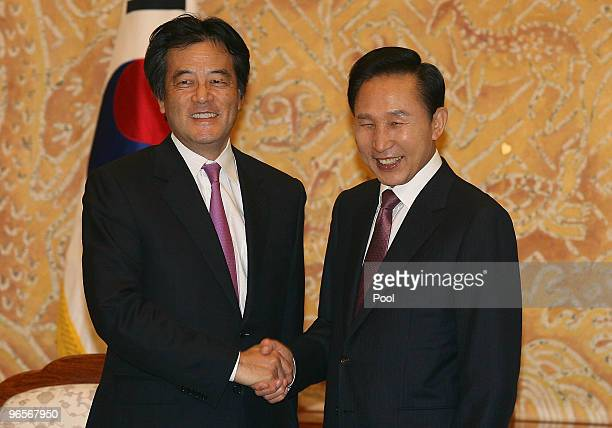 Japanese Foreign Minister Katsuya Okada shakes hands with South Korean President Lee MyungBak at the presidential house on February 11 2010 in Seoul...