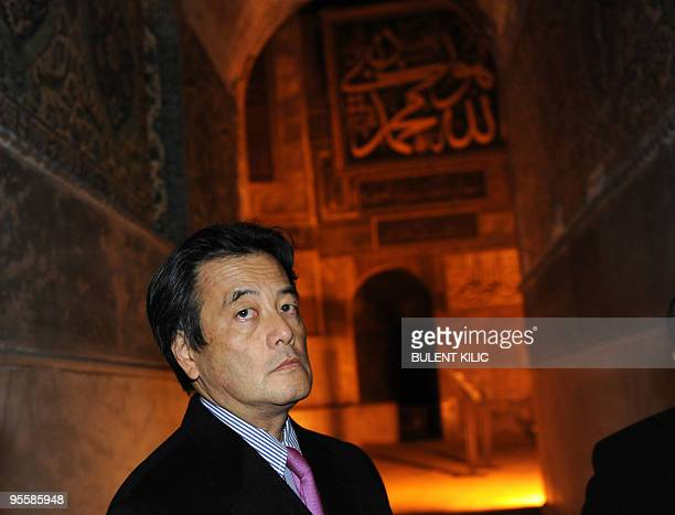 Japanese Foreign Minister Katsuya Okada stands in the Haghia Sophia Museum in Istanbul on January 3 2010 Okada is on an official twoday visit to...