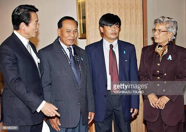 Japanese Foreign Minister Taro Aso chats with family members of Thai and Lebanese abductees by North Korea Mountaha Chehade Haidar Banjong Panjoy and...