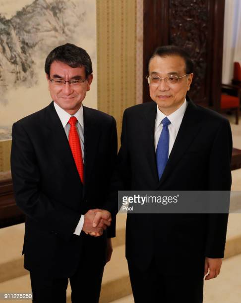 Japanese Foreign Minister Taro Kono and Chinese Premier Li Keqiang shake hands before their meeting at Zhongnanhai Leadership Compound on January 28...