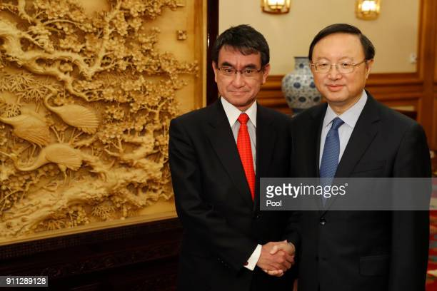 Japanese Foreign Minister Taro Kono and Chinese Premier Li Keqiang shake hands after their meeting at Zhongnanhai Leadership Compound on January 28...