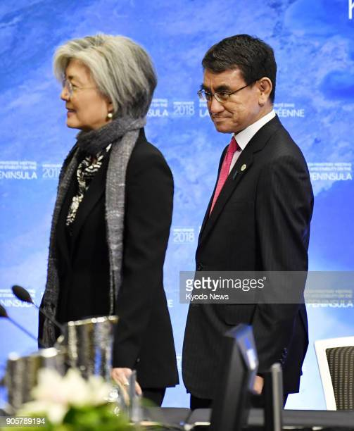 Japanese Foreign Minister Taro Kono and his South Korean counterpart Kang Kyung Wha walk together ahead of a meeting in Vancouver on Jan 16 2018 Kono...