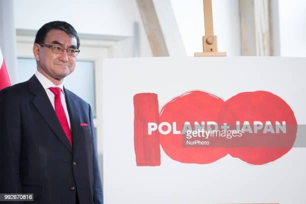 Japanese Foreign Minister Taro Kono and Polish Foreign Minister Jacek Czaputowicz present the logo of the 100th anniversary of the establishment of...