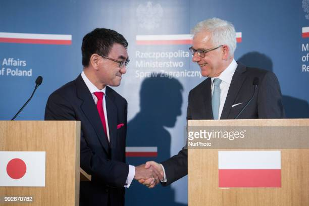 Japanese Foreign Minister Taro Kono handshake with Polish Foreign Minister Jacek Czaputowicz after the joint press conference at College of Europe in...