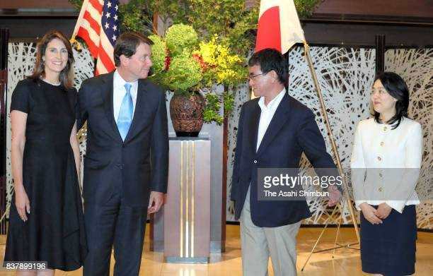 Japanese Foreign Minister Taro Kono his wife Kaori New US Ambassador to Japan William Hagerty and his wife Chrissy pose for photographs prior to...