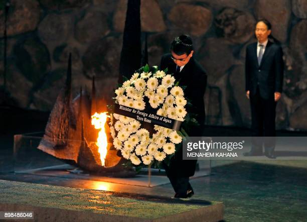 Japanese Foreign Minister Taro Kono lays a wreath at the Hall of Remembrance where the names of major death and concentration camps are written...