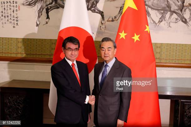 Japanese Foreign Minister Taro Kono left and Chinese counterpart Wang Yi pose for a photograph before their meeting at the Diaoyutai State Guesthouse...