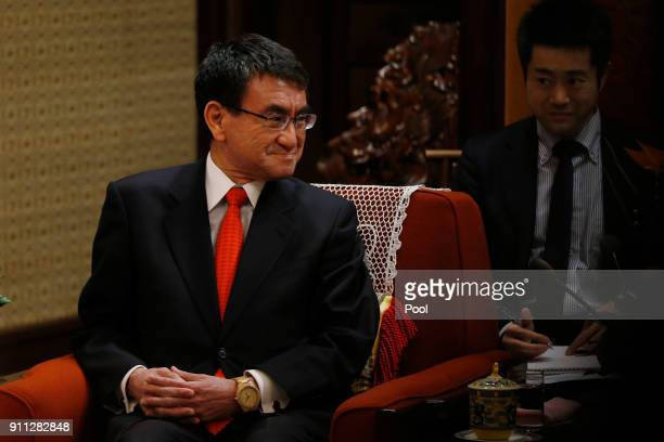 Japanese Foreign Minister Taro Kono listens to Chinese Premier Li Keqiang at Zhongnanhai Leadership Compound on January 28 2018 in Beijing China