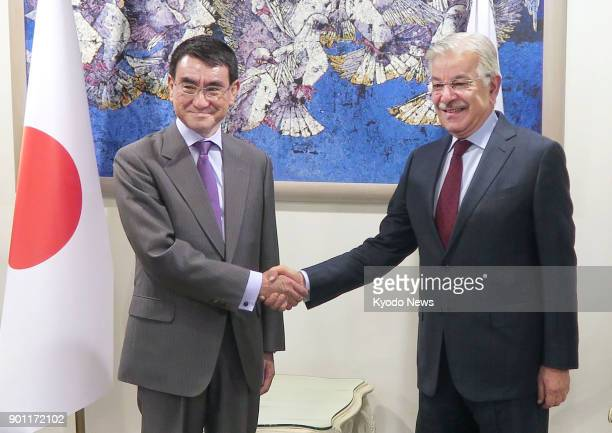 Japanese Foreign Minister Taro Kono shakes hands with his Pakistani counterpart Khawaja Asif before their talks in Islamabad on Jan 4 2018 ==Kyodo