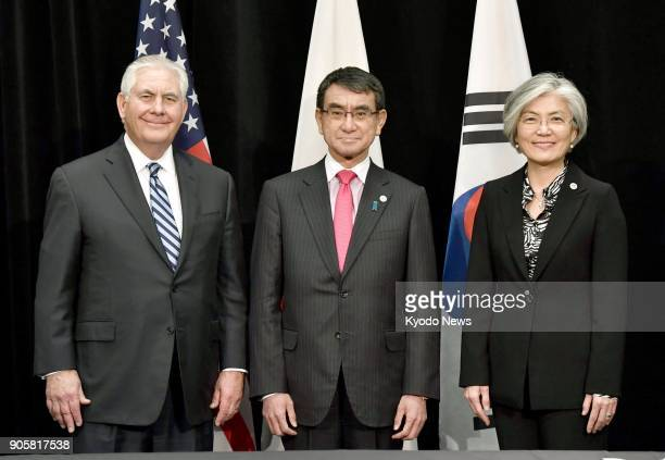 Japanese Foreign Minister Taro Kono US Secretary of State Rex Tillerson and South Korean Foreign Minister Kang Kyung Wha pose for a photo before...