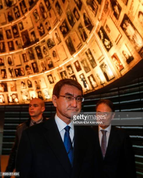 Japanese Foreign Minister Taro Kono views pictures of Jewish Holocaust victims at the Hall of Names during his visit to the Yad Vashem Holocaust...