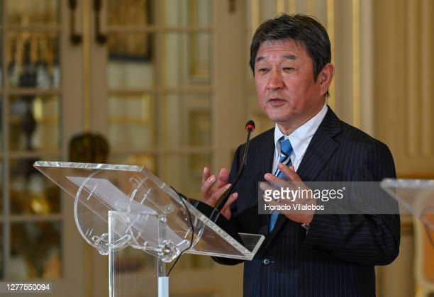 Japanese Foreign Minister Toshimitsu Motegi delivers remarks to the press with the Portuguese Minister of State and Foreign Affairs Augusto Santos...