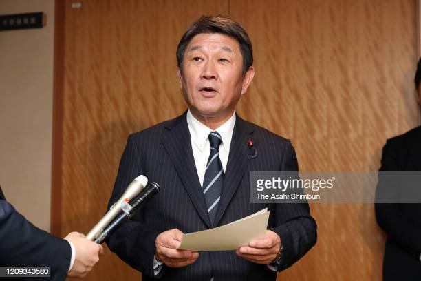 Japanese Foreign Minister Toshimitsu Motegi speaks to media reporters after his meeting with China's Central Foreign Affairs Commission Director Yang...