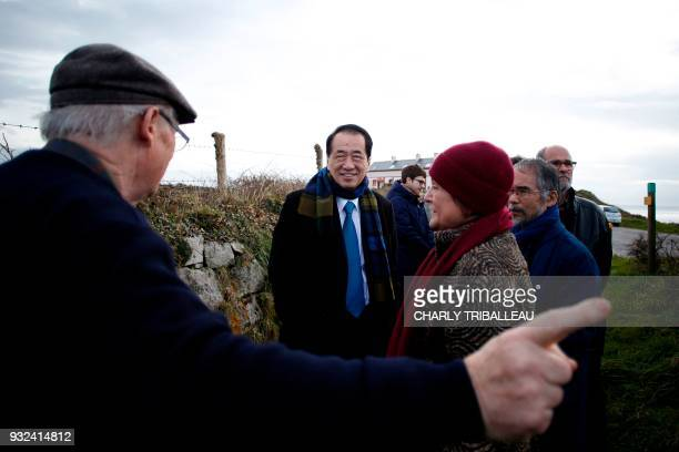 Japanese former prime minister Naoto Kan who was in office at the time of the disaster of Fukushima takes part in an antinuclear meeting near the...