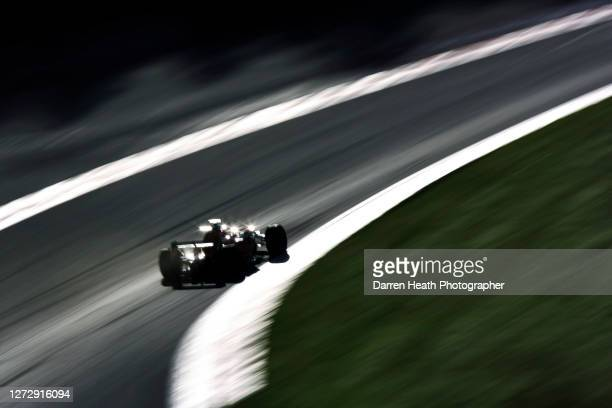 Japanese Formula One driver Sakon Yamamoto drives his Spyker F8-VII Formula One car through the Eau Rouge corner and up the Raidilllon corner during...