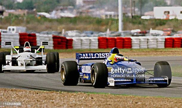 Japanese Formula One driver Shinji Nakano takes a turn with his Prost Mugen Honda followed by Dutch Jos Verstappen during the qualifying session 12...