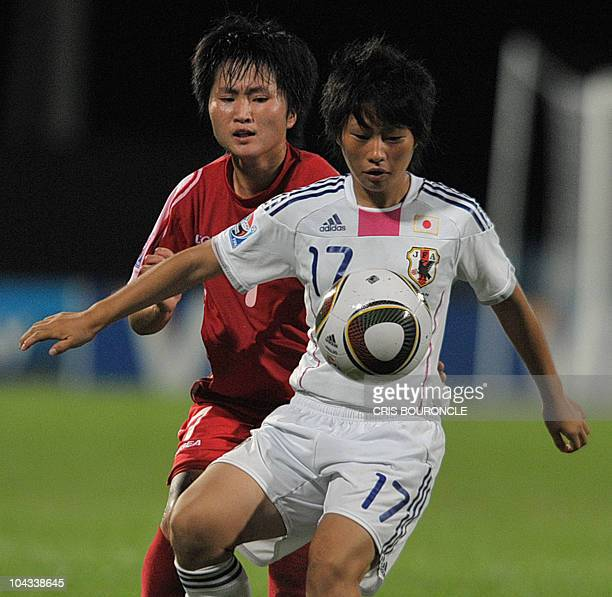 Japanese forward Kumi Yokoyama vies for the ball with North Korean defender Song Hwa Pong during the FIFA Women's Under17 semifinal match on...