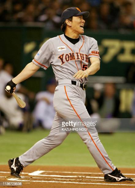 Japanese free agent slugger Hideki Matsui of Tokyo Yomiuri Giants smiles as he follows his home run during a home run derby session against San...