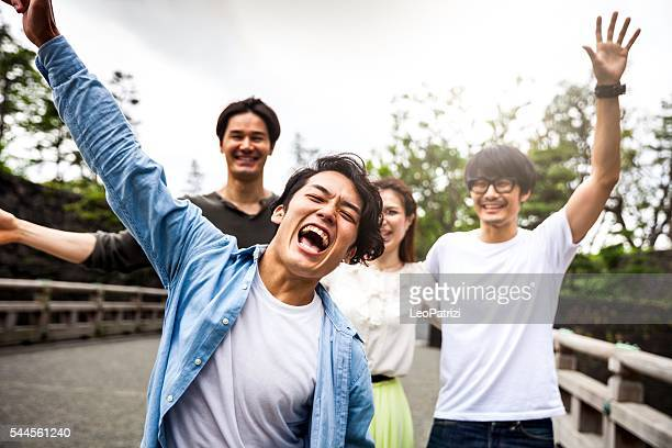 japanese friends hanging out together in the city - asian stock pictures, royalty-free photos & images