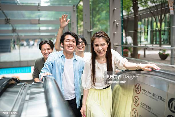 japanese friends happiness on the elevators