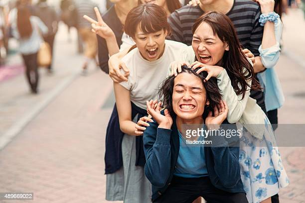 japanese friends having fun - teasing stock pictures, royalty-free photos & images