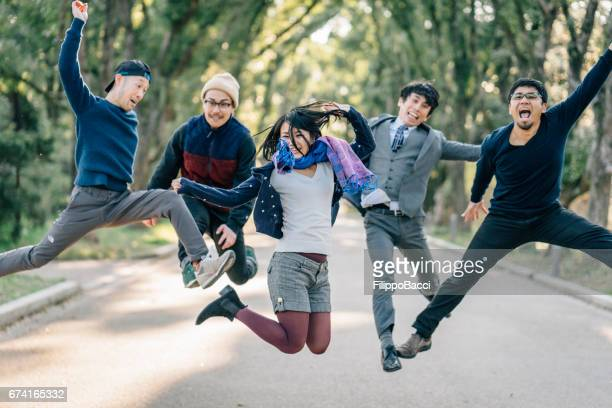 Japanese friends jumping together