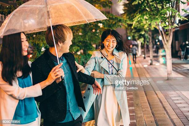 Japanese friends outside in the rain