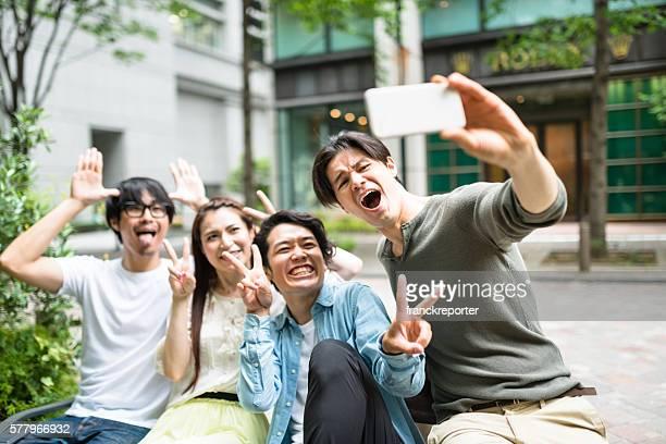 japanese friends take a selfie in Tokyo Shibuya