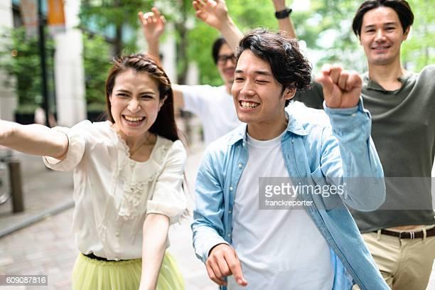 japanese friends walking in tokyo
