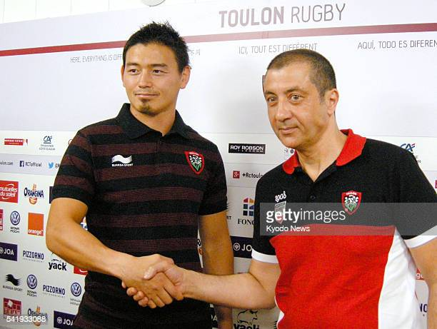 Japanese fullback Ayumu Goromaru shakes hands with Toulon owner Mourad Boudjellal as he is introduced by the French rugby club at a press conference...