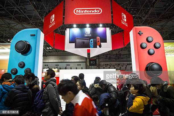 Japanese gamers lineup to try the new video game during the new console's unveiling 'Nintendo Switch' by Nintendo Co on January 14 2017 in Tokyo Big...