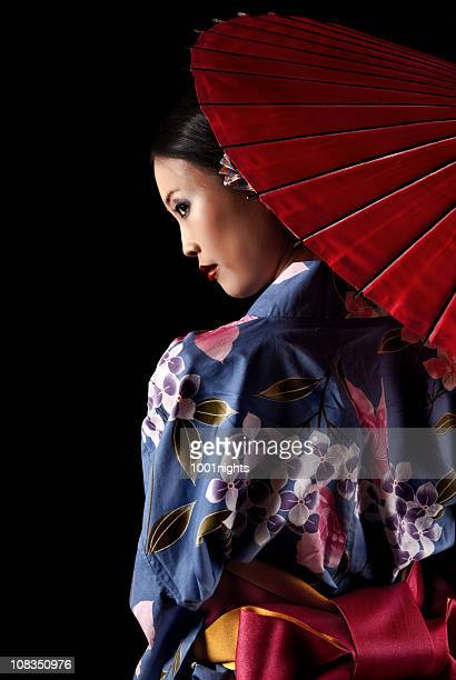 Japanese geisha with a red umbrella