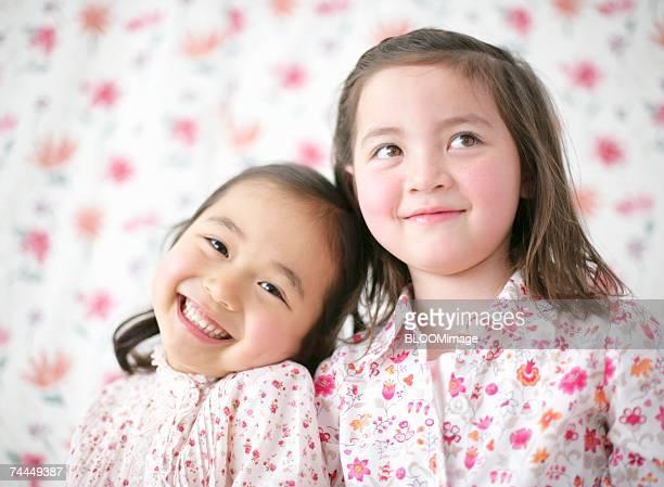 Japanese girl and American girl smiling