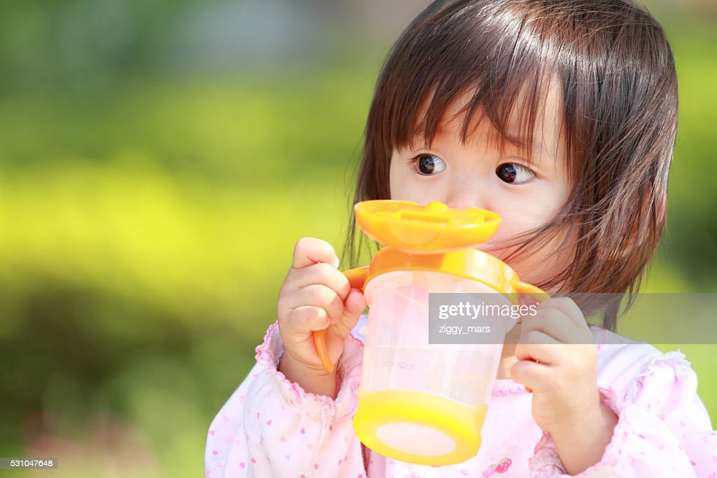 Japanese girl drinking water (1 year old) : Stock Photo
