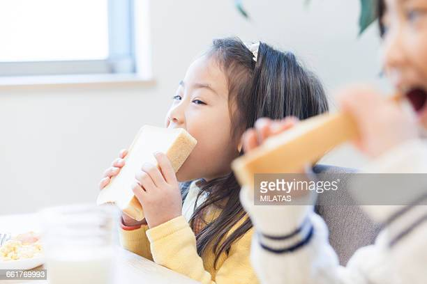 Japanese girl eating bread
