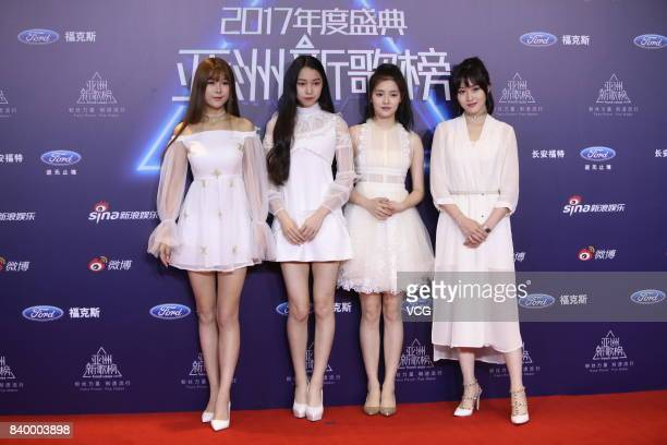 Japanese girl group AKB48 pose on the red carpet of the 2017 Fresh Asia music awards ceremony on August 27, 2017 in Beijing, China.