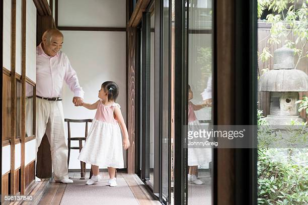 Japanese girl holding hands with grandfather