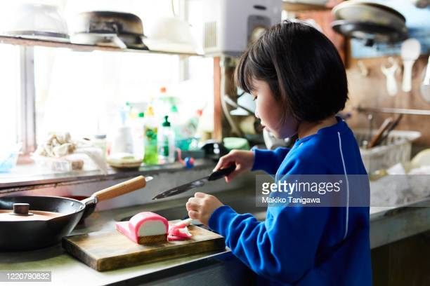 japanese girl in kitchen at home - osechi ryori stock pictures, royalty-free photos & images