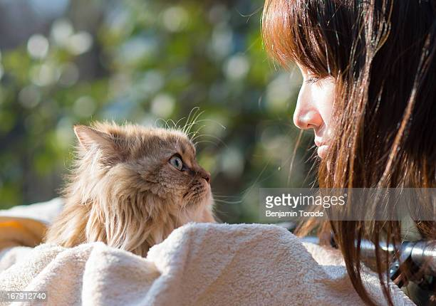 Japanese girl looking at cat