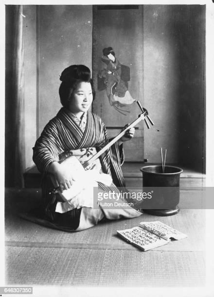 A Japanese girl playing a samisen